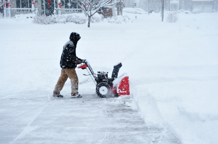 An unidentifiable person Snow Blowing During Blizzard in Deep Accumulation of Snow